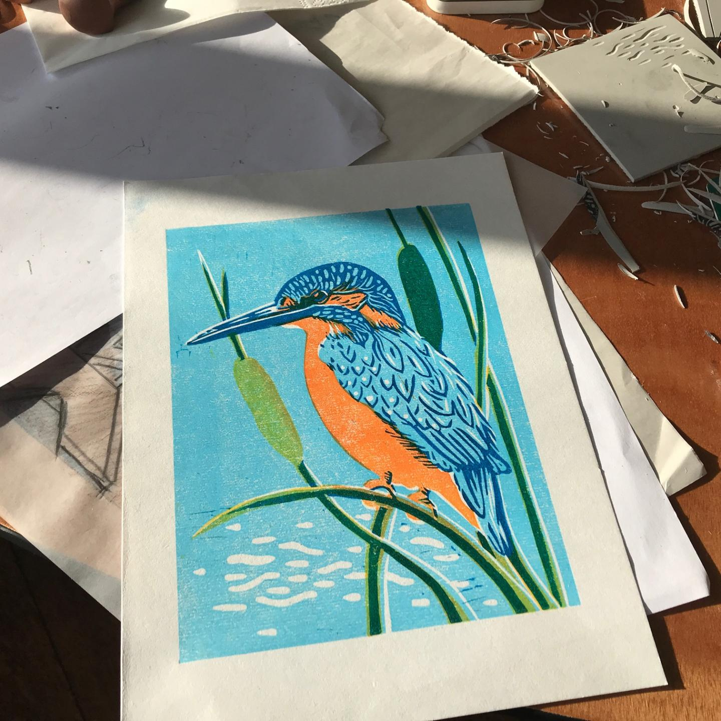 A Barle river kingfisher captured in linocut at Knapp House creative Luna North course