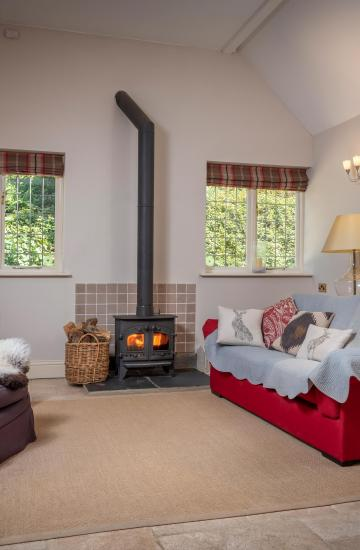 Wood Burner in Lounge at Knapp House Self Catering Lodges in Devon